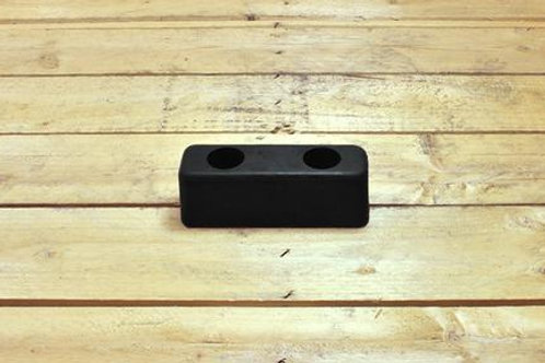 black rubber hgv bumper on a wooden table