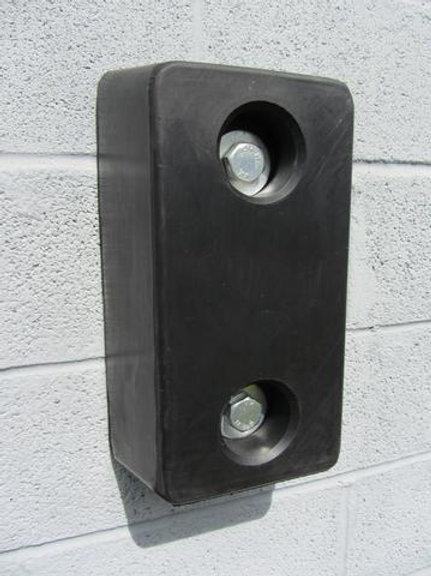 black rubber dock bumper on blue wall