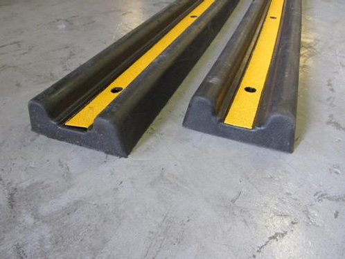 black and yellow wall guard on a concrete floor