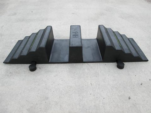 black hose and cable ramp on concrete floor
