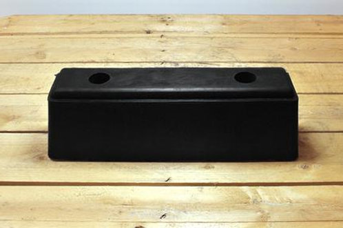 black hgv rubber bumper on wooden table