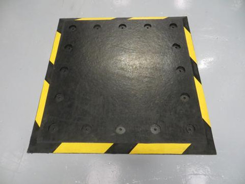 black and yellow trailer plate on concrete floor