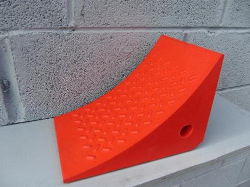 orange hgv wheel chock on a shelf