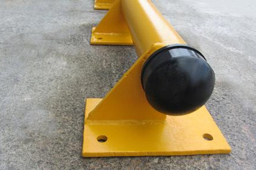 yellow kerb with black end cap on concrete floor
