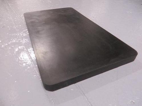 black rubber packer on concrete floor