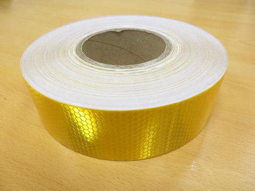 gold reflective tape on wooden floor