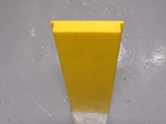 yellow front plate on warehouse floor