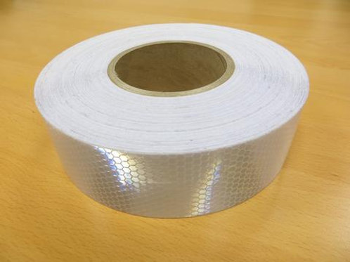 white reflective tape on wooden floor