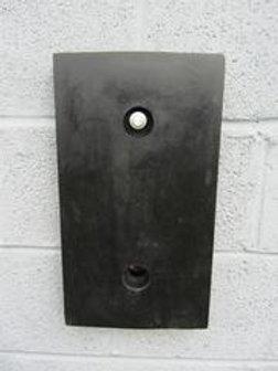 black rubber packer on brick wall