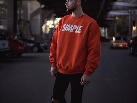 Colton in the Orange SIMPLE® Champion Crewneck | Photos by Mark Enriquez