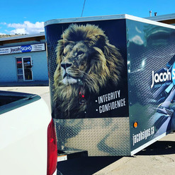 Jacoh Signs trailer wrap. Custom graphic design work and branding elements.