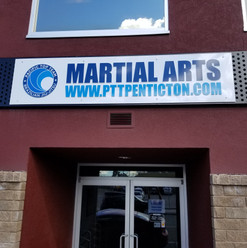 Entrance sign with cut vinyl decals