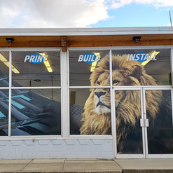 Jacoh Signs large format print window wrap. Perforated vinyl helps to provide extra natural light.