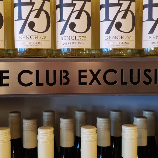 Custom designed and created aluminum laser cut signs for winery club exclusive racks