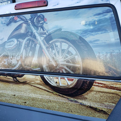 Perforated truck window vinyl with extended large format graphics