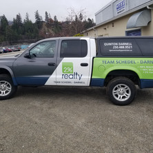Auto decals and graphics for 1% Realty truck.