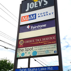 Pylon sign with plaza directory and backlit graphics