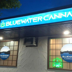 Bluewater Cannabis backlit sign cabinet with translucent graphics. Custom fabricated sign cabinet with backlit LED lighting.