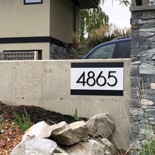 Custom made address sign with 3D lettering and brushed aluminum background