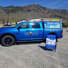 Trivium Truck vinyl decals and sandwich board. Designed, supply and installed by local sign shop in Penticton BC.