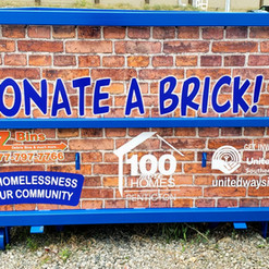 Recycling bin large format print wrap. Helping to end homelessness in our community.