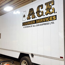 Layered metallic fleet vehicle graphics for ACE courier.