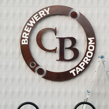 Cannery Brewing sign customer designed and hand rusted. Installation with bucket truck.