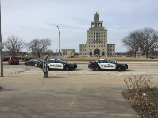 Two CRPD Police Cars against Vets Auditorium Background on Third Avenue