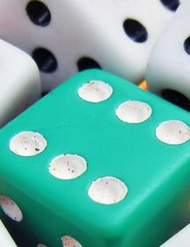Green and white dice - six showing on green die