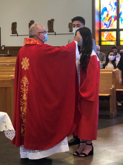 Girl being Confirmed by Msgr. Peter