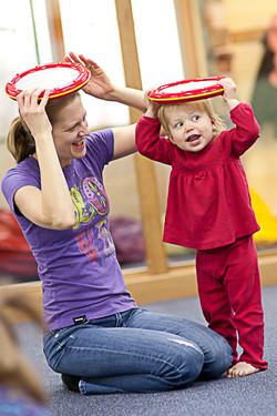 Photo-Kindermusik-Toddler-Mom-Girl-Tambourine-Play