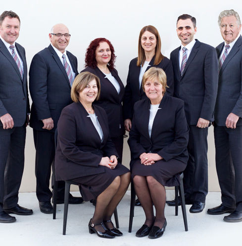 A group photograph of the staff from Peter Elberg Funerals