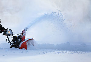 man working with snow blower after winte