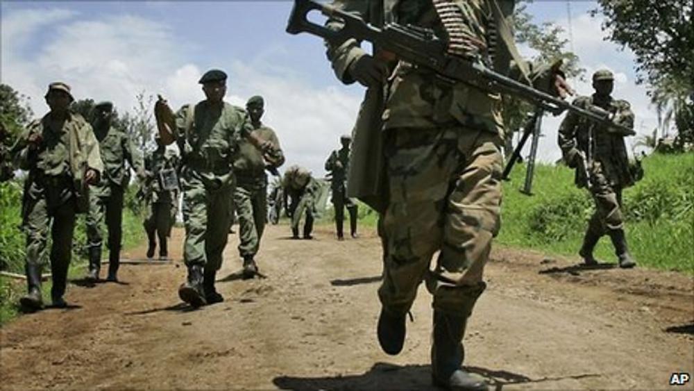 Military figures march in the Democratic Republic of Congo (Photo: BBC / AP)