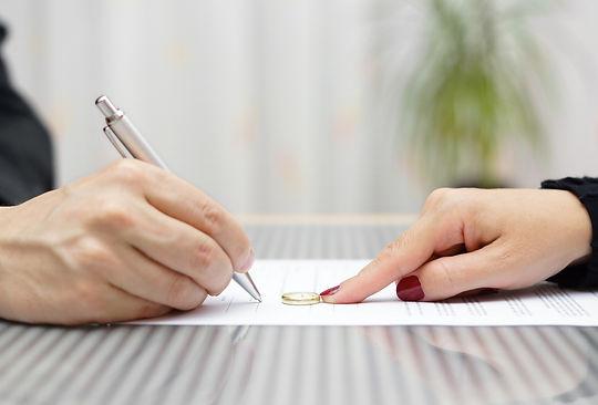 bigstock-Husband-Signing-Divorce-Agreem-