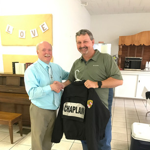 Passing of the baton from retired MSP Chaplain, Pastor Hal Adkins