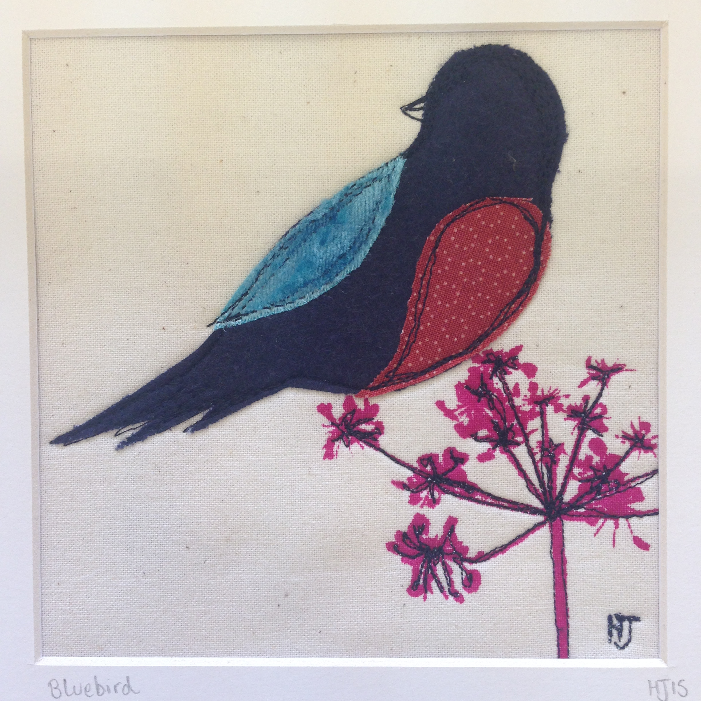 Bluebird on Seedhead