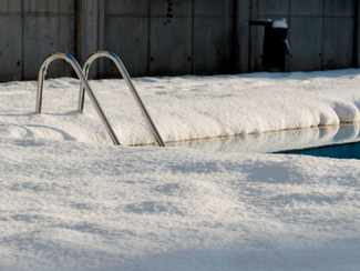 Do I need to have my pool serviced in the winter months?