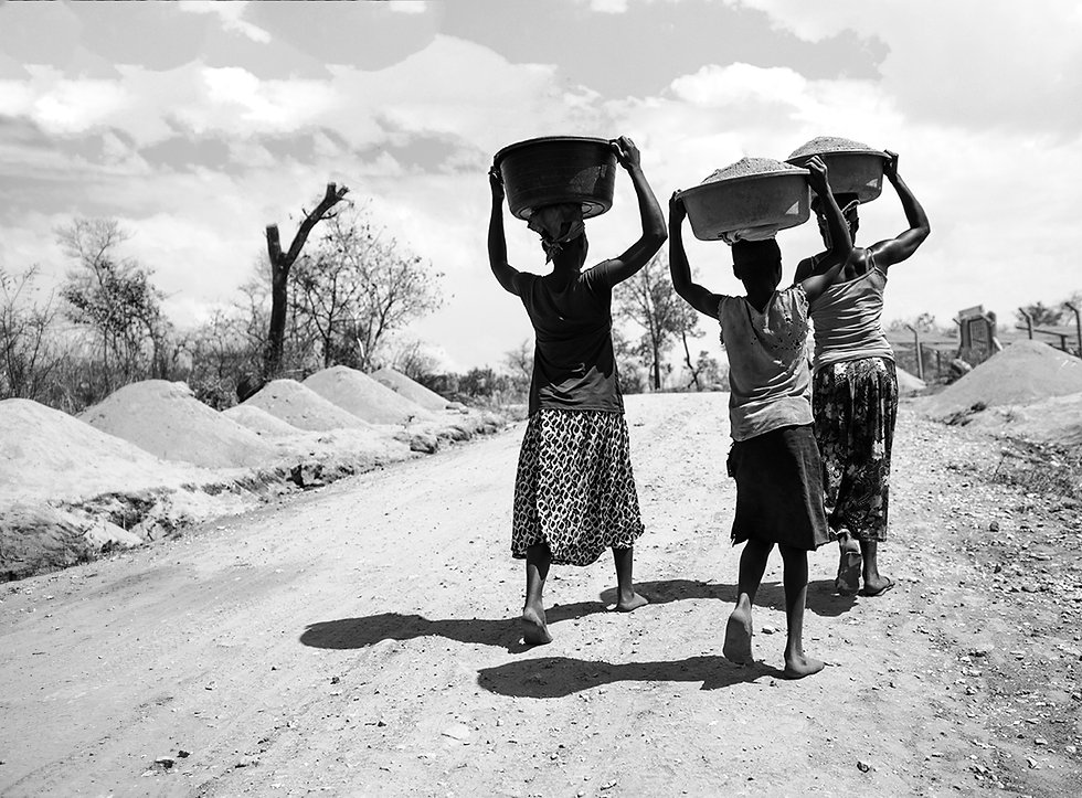 three%20women%20carrying%20basin%20while