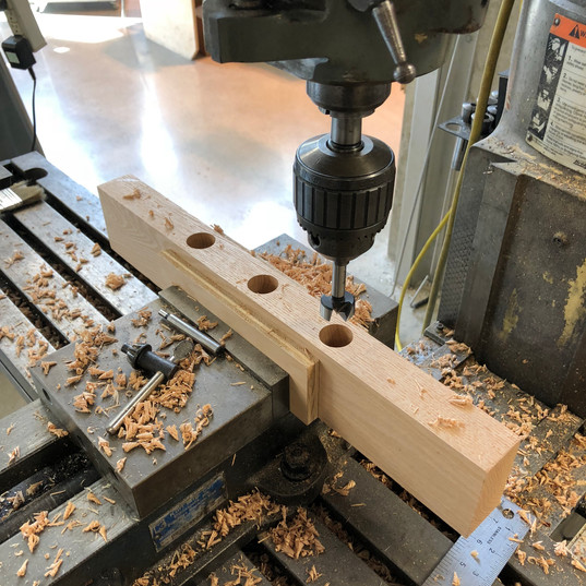 Drilling holes for dowels on mill