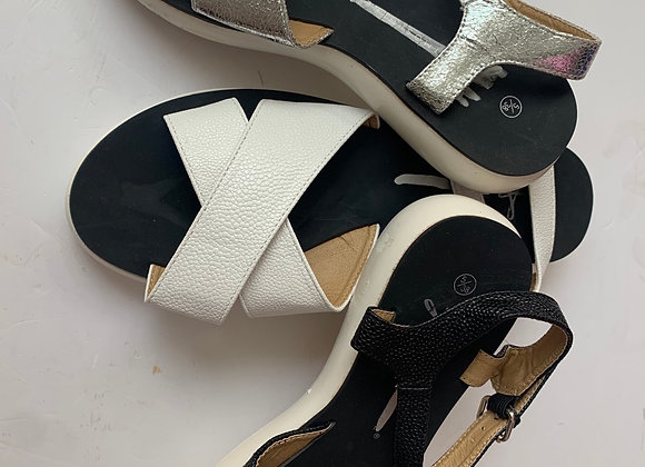 Comfort white and black fly flat sandals with feature upper and buckle fastening