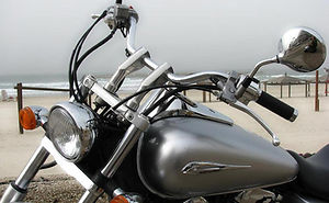 Motorcycle Accident Attorney Photo of Silver Motorcycle handlebars