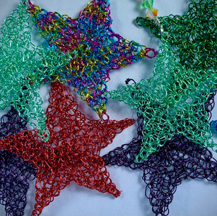 Hand Knit stars in a rainbow of color