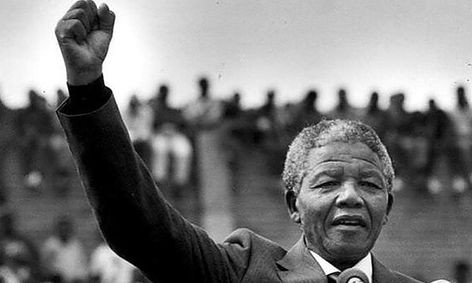 Mandela raises his fist at public gathering shortly after his release from prison.