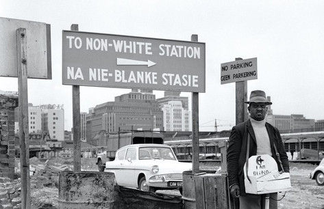 A sign indicates directions to the non white area of a train station.