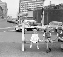White children on a whites only bench.