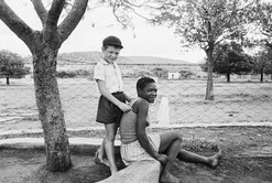 In rural South Africa many black and white children grew up together as friends only to be separated by apartheid later in life.