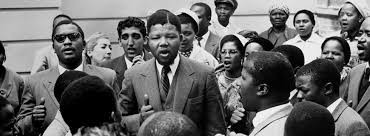 Nelson Mandela speaks outside a courthouse in the 1950's.