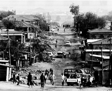 The townships of South Africa were harsh places to live with little to no running water, electricity, indoor plumbing or sanitation for the majority of inhabitants.
