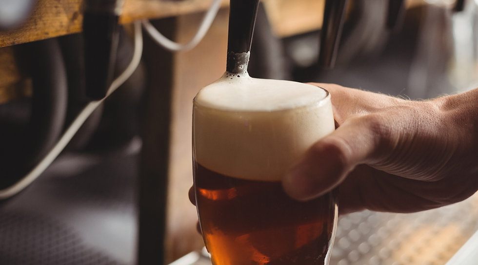close-up-of-bar-tender-filling-beer-from